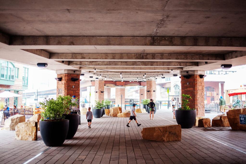 photogenic outdoor mall below overpass